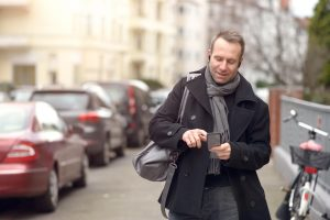 BeHear NOW headset use case: man walking down crowded street
