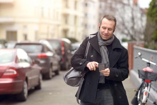 BeHear NOW headset use case: man walking down crowded street